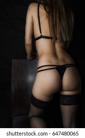beautiful young woman back with black lingerie