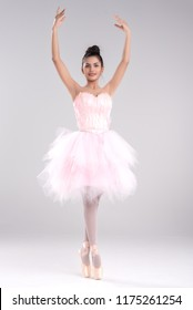 Beautiful young woman ballerina show ballet dance,dress in fink feather,professional outfit,Beauty of classic ballet.