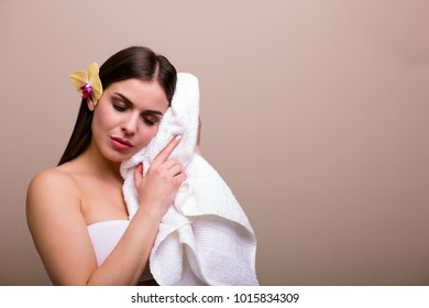 Beautiful young woman with a bath towel