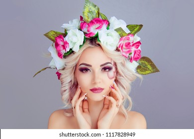 Beautiful young woman beauty and fashion portrait with wreath headband of pink white roses flowers painting on face looking at you isolated on light purple background wall in studio horizontal shot.