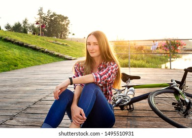 beautiful young woman with bicycle