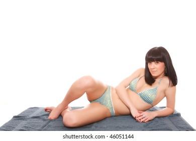 A Beautiful young woman in bikini isolated on white