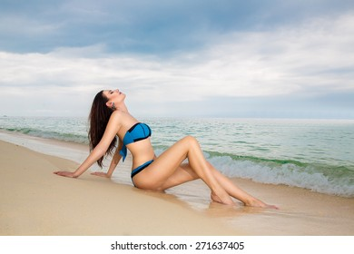 beautiful young woman in bikini on a tropical beach