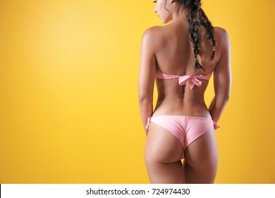 Beautiful young woman in bikini on color background