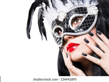 Beautiful young woman in black carnival mask with manicure on white background