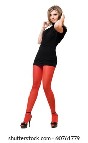 Beautiful young woman in a black dress and red tights