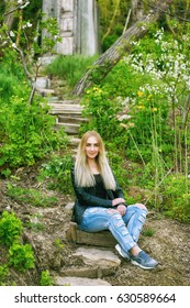 beautiful young woman blonde in the old garden
