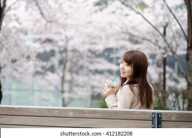 beautiful young woman in blooming cherry blossoms