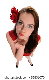 Beautiful young woman blowing kisses - High view angle isolated over white