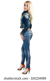 Beautiful young woman in a blue denim suit.