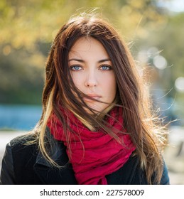 Beautiful young woman with blue eyes. Autumn portrait.