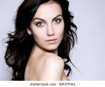 beautiful young woman with blue eyes, flawless skin and perfect make-up