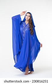 Beautiful young woman in blue tunic Arabic, on white background