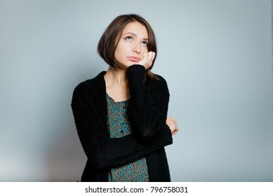 beautiful young woman bored at work, isolated on background, studio photo