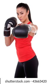 Beautiful young woman at a boxing workout in the gym
