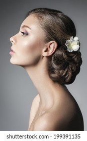 Beautiful young woman with bridal makeup and hairstyle. Wedding trends
