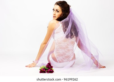 Beautiful young woman bride  with bouquet of tulips