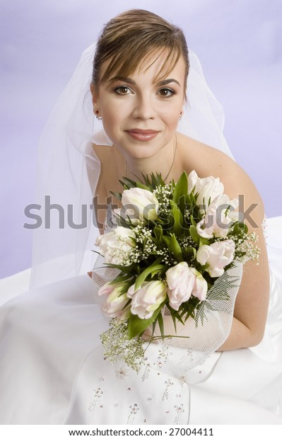 Beautiful young woman bride in white dress