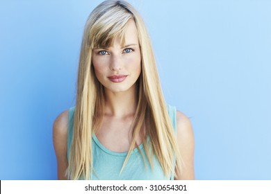 Beautiful young woman with bright blue eyes