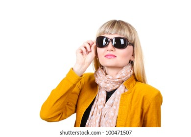 Beautiful young woman in bright jacket with sunglasses isolated on white