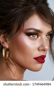 Beautiful young woman with bright make up