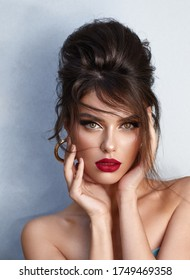 Beautiful young woman with bright make up and red lips