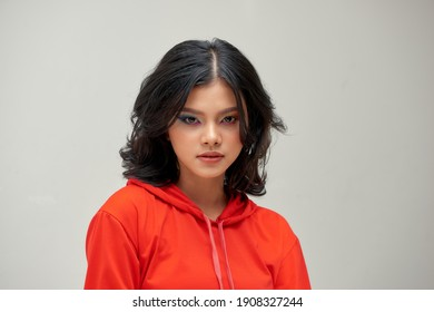 Beautiful young woman with bright makeup on gray background