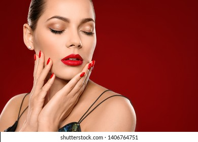 Beautiful young woman with bright manicure on color background, space for text. Nail polish trends