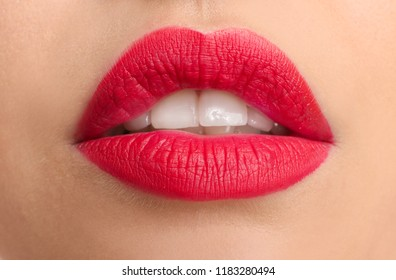 Beautiful young woman with bright red lipstick, closeup