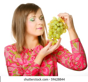 Beautiful young woman with bunch of grape.