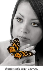 Beautiful young woman with butterfly on hand
