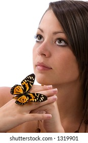 Beautiful young woman with butterfly on hand and white background