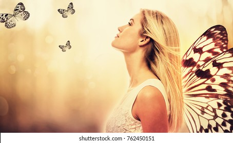 Beautiful young woman with butterfly wings on her back