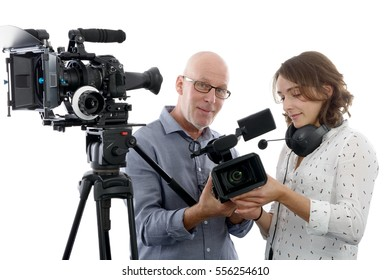 beautiful young  woman cameraman, and the mature man