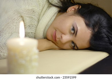Beautiful young woman with candle