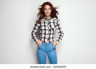 beautiful young woman in checked shirt blue jeans and wonderful hair.