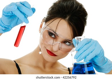 Beautiful young woman with chemical glassware isolated over white background