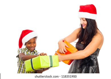 Beautiful young woman and child boy opening Christmas gift boxes, isolated on white background.