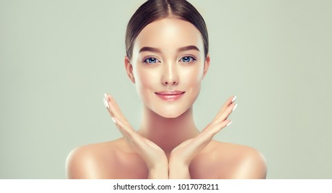 Beautiful young woman with clean fresh skin. Girl beauty face care. Facial treatment.