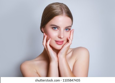 Beautiful Young Woman with Clean Fresh Skin look in camera .Girl beauty face care. Facial treatment . Cosmetology , beauty and spa .