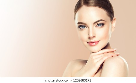 Beautiful young woman with clean fresh skin. Spa and face care