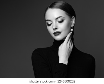 Beautiful Young Woman with Clean Fresh Skin. Perfect Makeup. Beauty Fashion. Cosmetic Eyeshadow. Smooth Hair. Girl in Black Turtleneck. Black and White