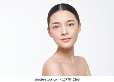 Beautiful Young Woman with Clean Fresh Skin. Face care . Facial treatment . Cosmetology , beauty and spa. Asian women portrait .