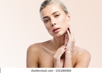 Beautiful young woman with clean fresh skin. Beauty girl face care. Facial treatment.  Cosmetology, beauty and Spa