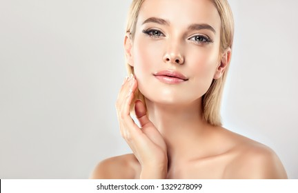Beautiful Young Woman with Clean Fresh Skin . Facial  treatment   . Cosmetology , beauty  and spa . Blonde girl with short hair and a clean face.