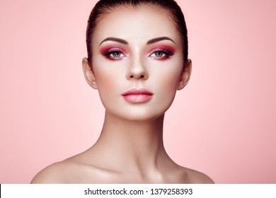 Beautiful Young Woman with Clean Fresh Skin. Perfect Makeup. Beauty Fashion. Eyelashes. Cosmetic Eyeshadow. Highlighting. Cosmetology, Beauty and Spa