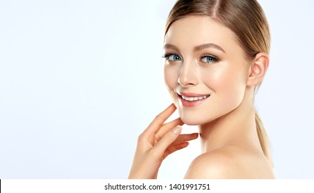 Beautiful Young Woman with Clean Fresh Skin . Facial  treatment   . Cosmetology , beauty  and spa . Nice and attractive girl with a pleasant smile.