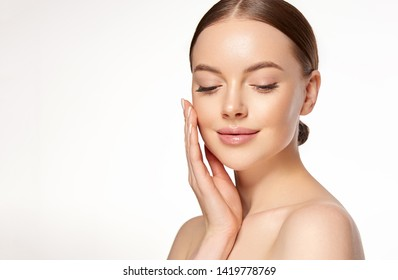 Beautiful young woman with clean fresh skin on face . Girl facial  treatment   . Cosmetology , beauty  and spa .  - Shutterstock ID 1419778769