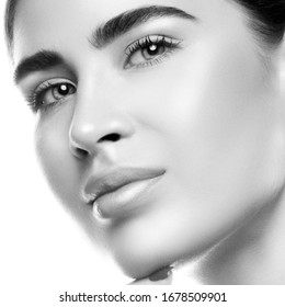 Beautiful Young Woman with Clean Fresh Skin. Close up Portrait. Fashion Model Girl Face. Perfect Skin. Professional Makeup. Fashion shiny highlighter on skin, sexy gloss lips. Black and white