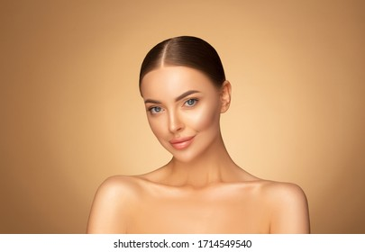 Beautiful young woman with clean fresh skin look away. Girl beauty face care. Facial treatment. Cosmetology, beauty and spa.